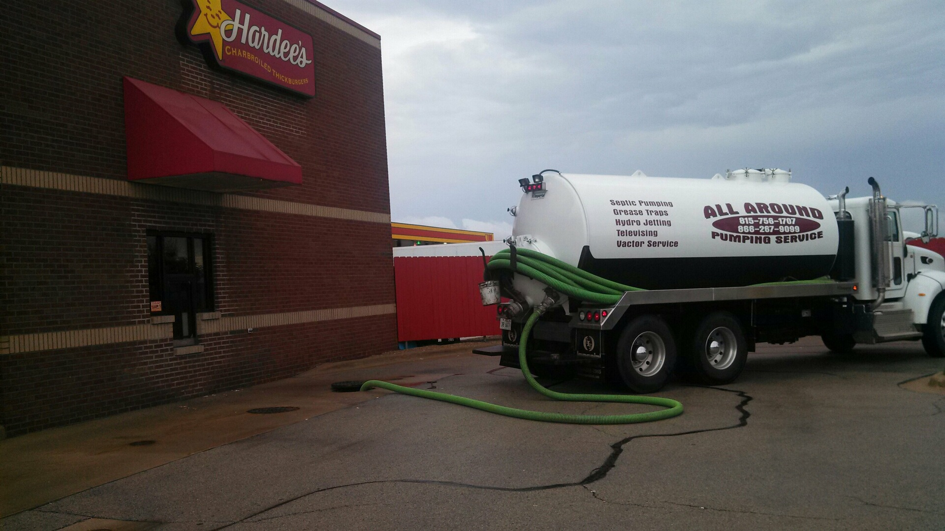 Cleaning Hardees Restaurant Grease Trap