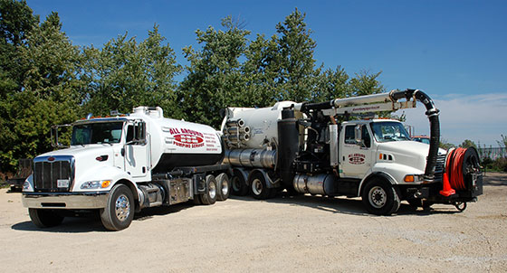 2 Septic Pumping Trucks